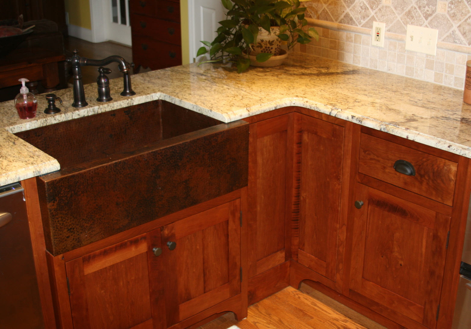 lazy susan still need to add some base molding along cabinet bottom