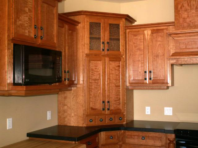 Figured ropey cherry kitchen for Corner kitchen cabinet