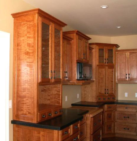 Figured ropey cherry kitchen - Kitchen display cabinets ...