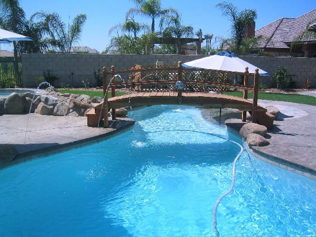 Swimming Pool Bridge Build : Handcrafted redwood garden bridges