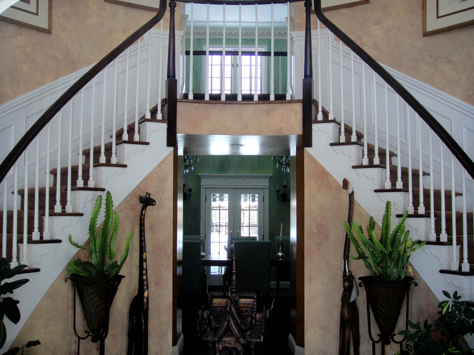 Architectural detailing for a foyer for Double curved staircase