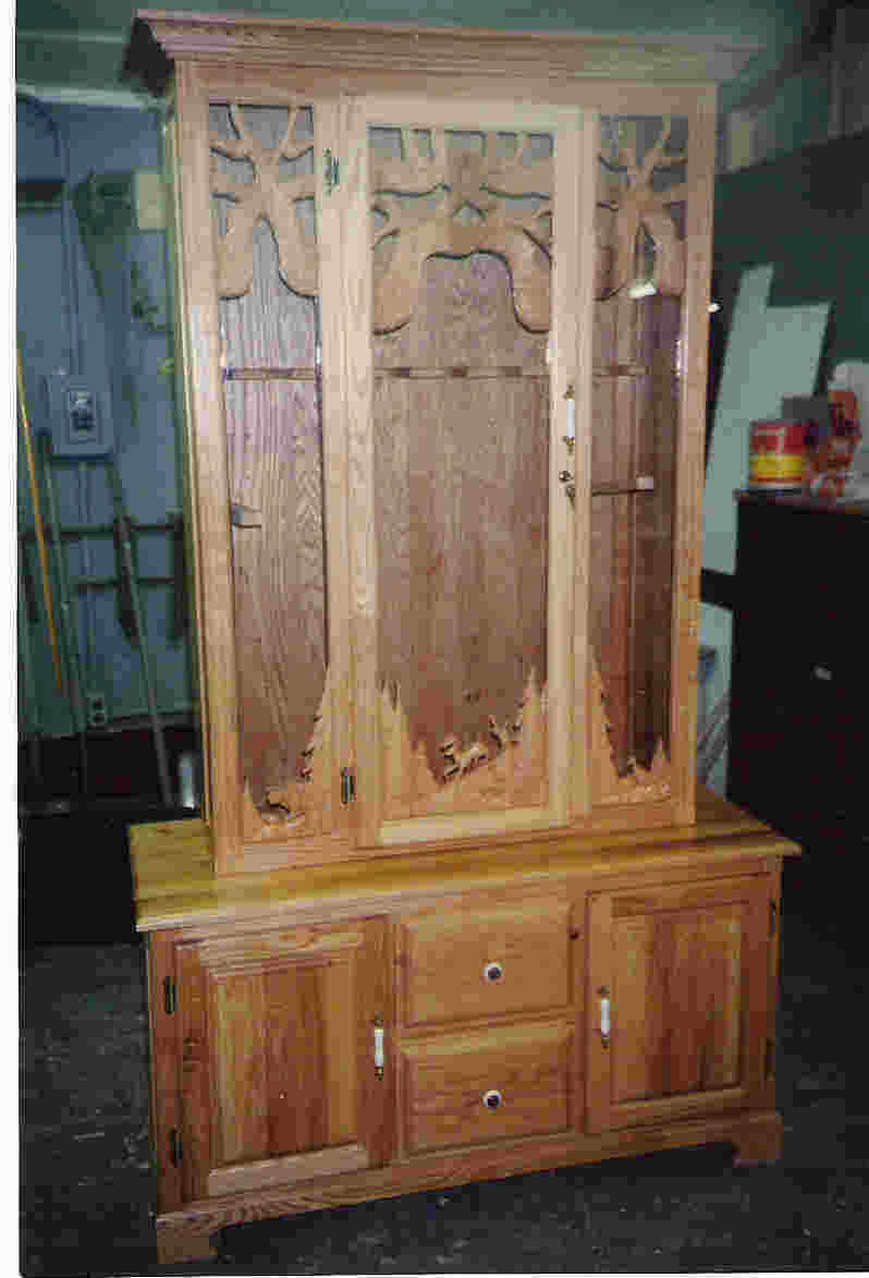 carved gun cabinet