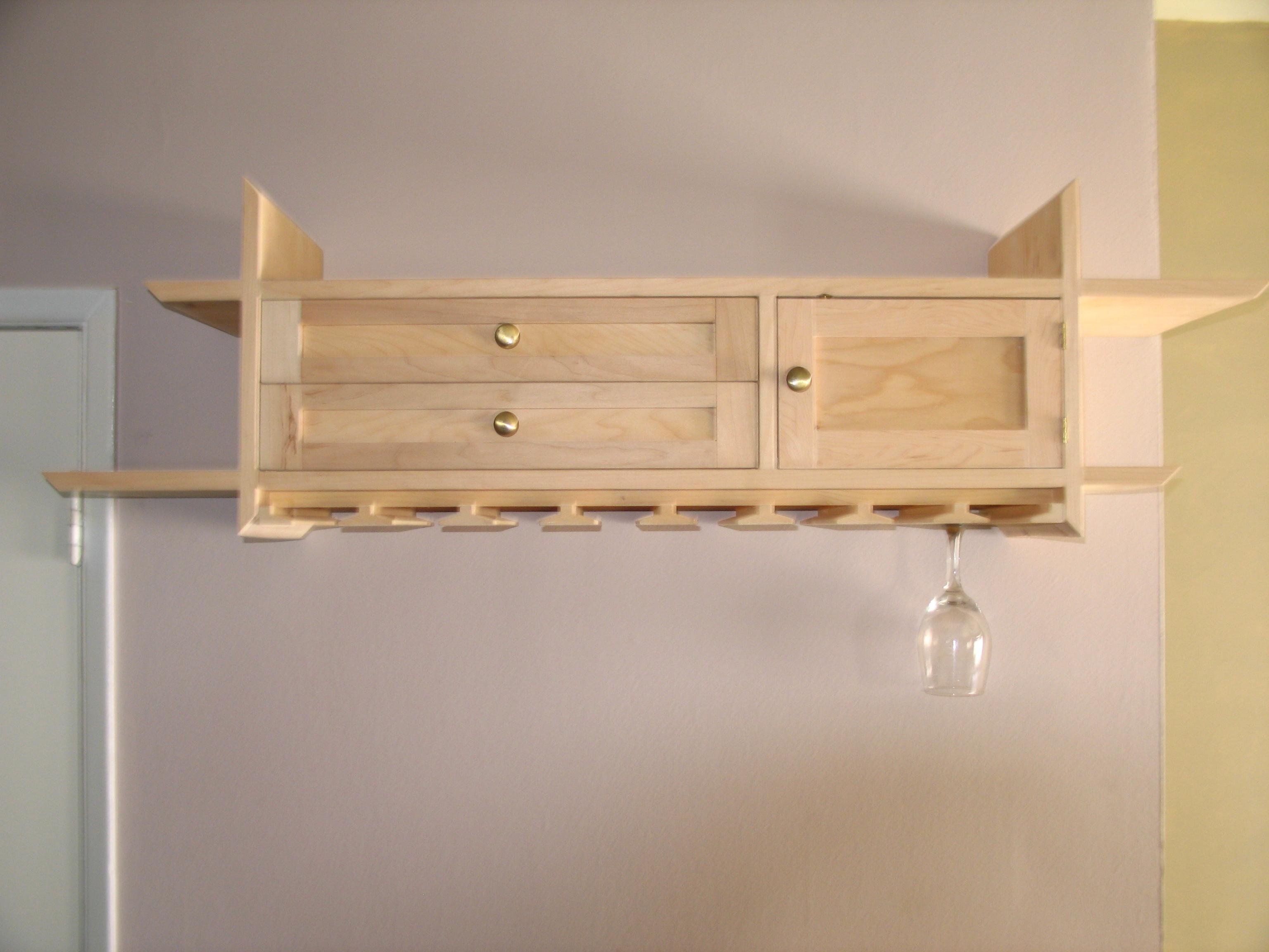 Wine glass rack with drawers and door out of reach of little hands