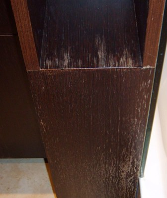 water damage to a bath cabinet finish