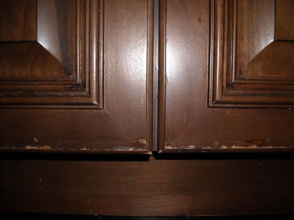 cabinet door finish failure diagnosis and repair rh woodweb com how to repair cabinets melamine how to repair cabinets from water damage