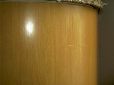 Cross Grain Scratches Caused By Scaffolding Being Run Into The Cabinet.  Door Is Radiused And Right Next To An Exterior Door With A *lot* Of  Sunlight.
