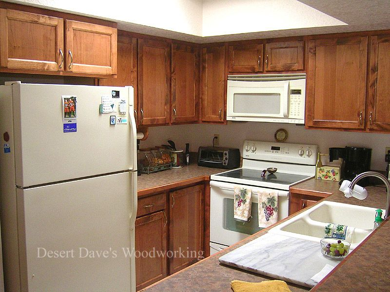 Upper cabinets adjacent to a microwave for Upper kitchen cabinets